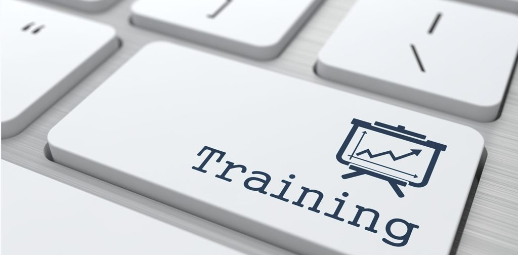 close-up of laptop keyboard, one key says 'training'