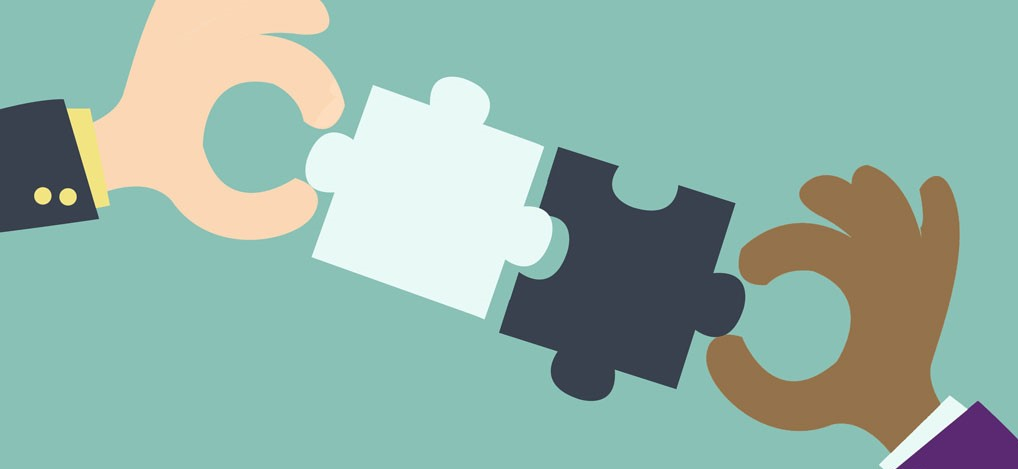 Two jigsaw pieces being joined together