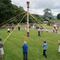 May Day event at Halsway Manor House - people dance around the maypole